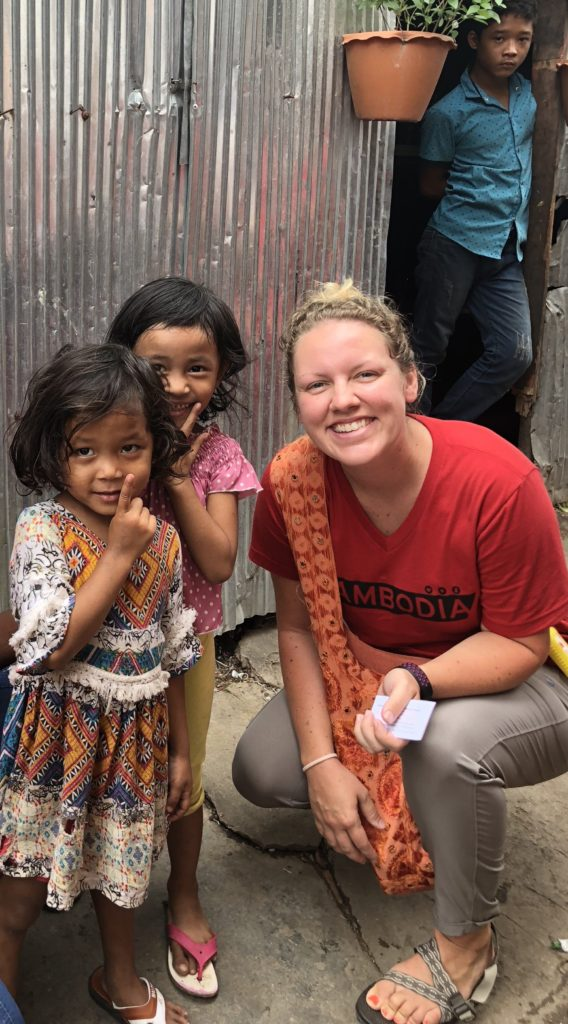 Walking through neighborhoods in Cambodia loving people and sharing the word about bringing their children to Saving Moses nightmare centers