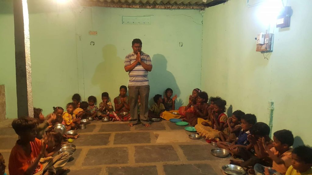 A dear friend of Awaken Ministries who pastors a church in India , praying with the children.